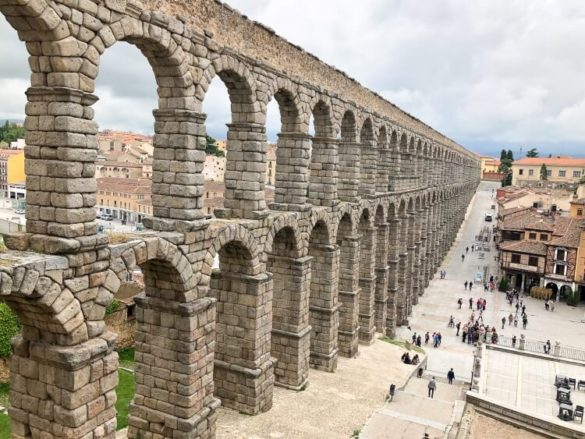 Roman aqueduct in Segovia is the most iconic attraction on a day trip, one day in Segovia Spain must see tourist site