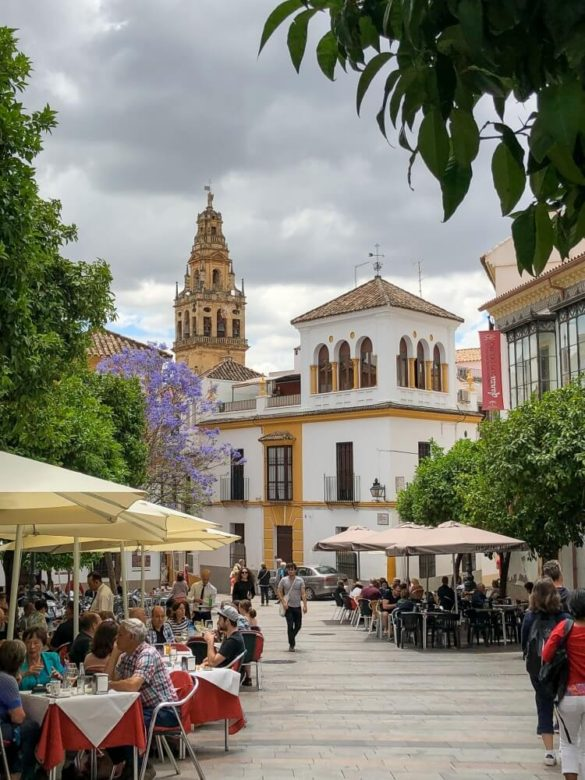 pretty streets in Cordoba with Mezquita in background