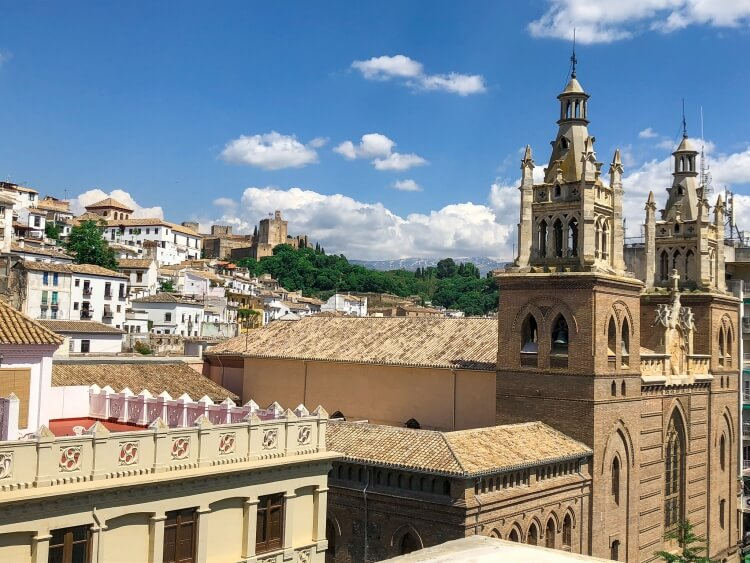 view of Alhambra, cathedral and sierra Nevada mountains from pension