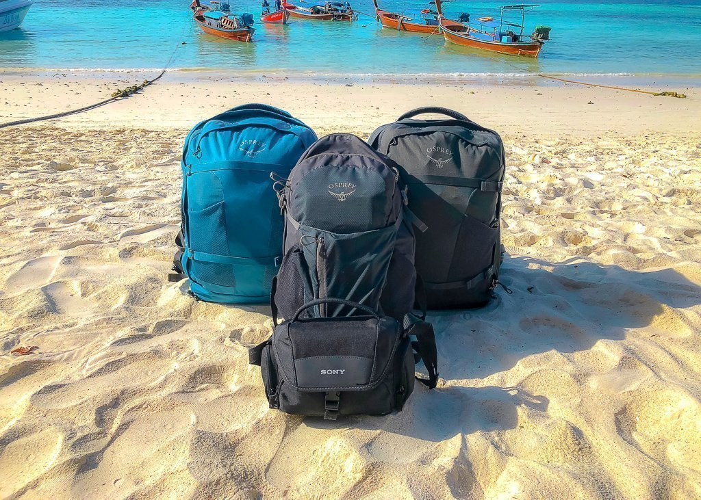 3 osprey backpacks and one sony camera case on pattaya beach in koh lipe thailand pack bags