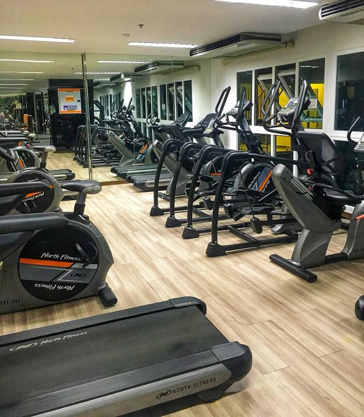 gym with ellipticals, treadmills and weights