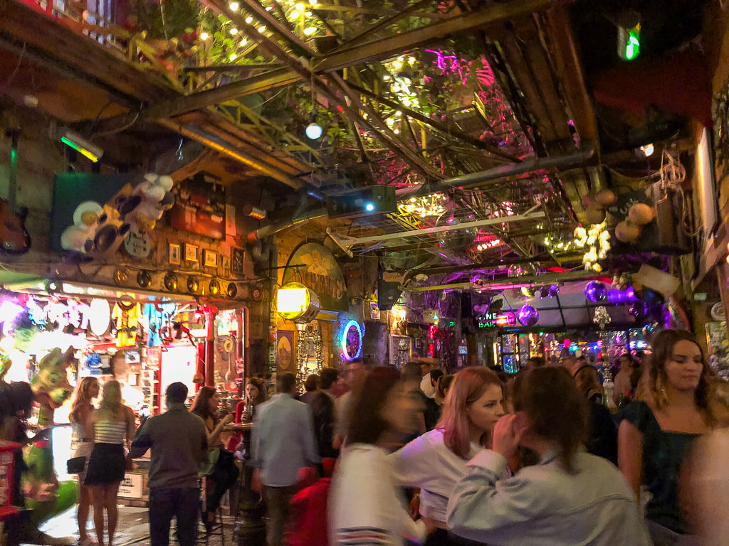 Tourists drinking and dancing inside Szimpla Kert at night