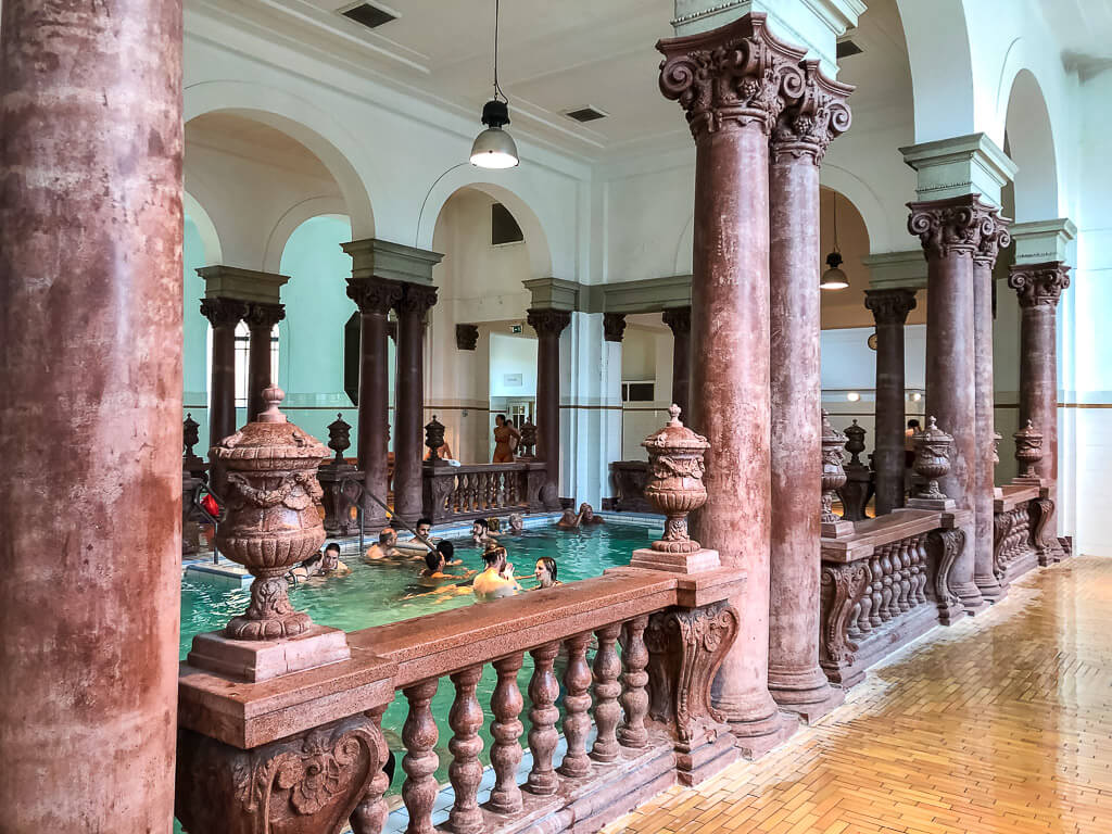 heated indoor pool szechenyi baths with roman columns