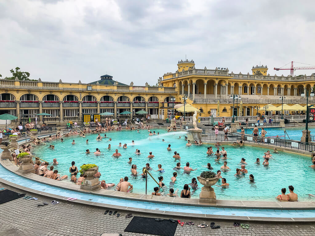 one of three szechenyi baths outdoor pools crowded