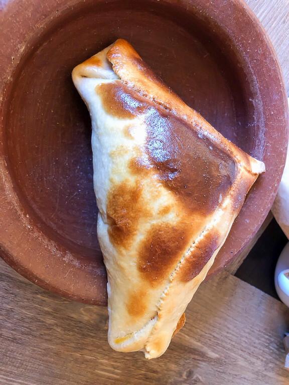 empanada at Emporio Andino beef and vegetable in golden crust
