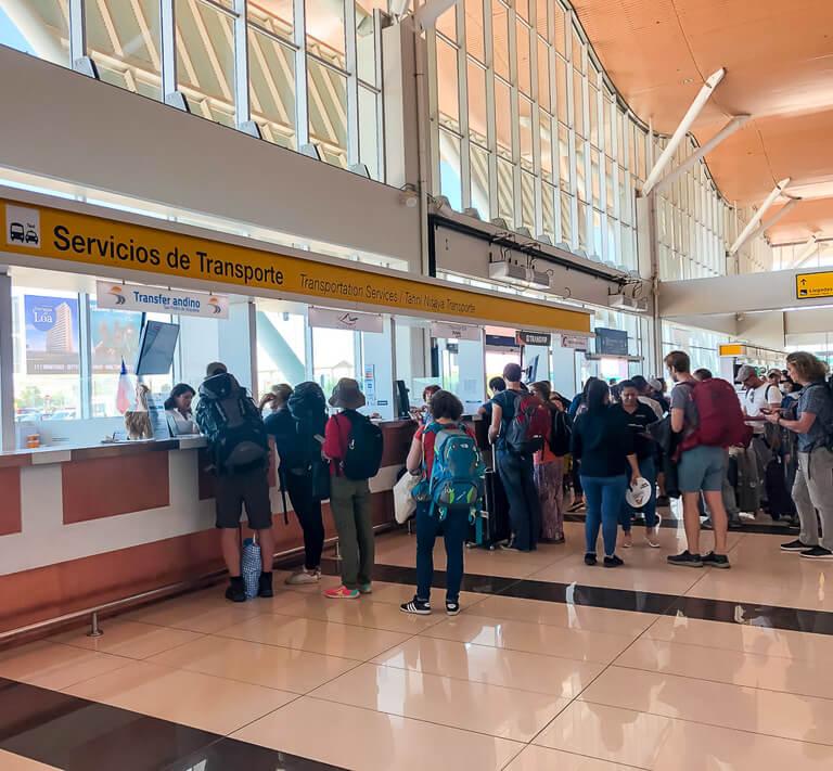 line for bus tickets inside Calama Airport start of San Pedro de atacama itinerary