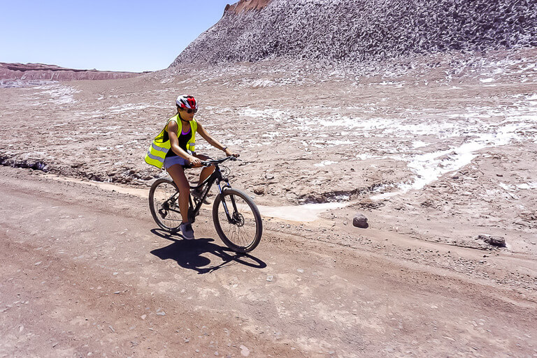 kristen carefully riding her bike through valle de la luna