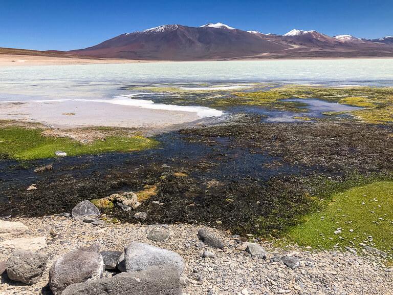 colorful laguna with mountains behind near San Pedro