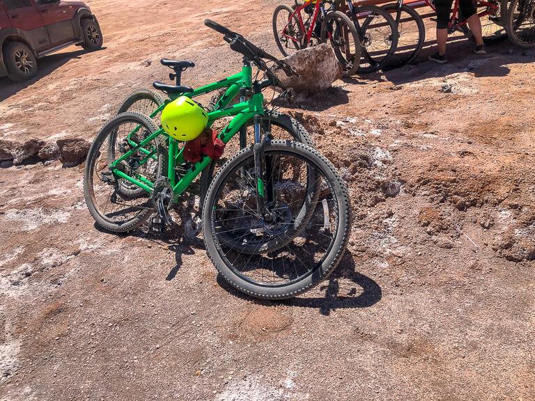 mark and Kristen mountain bikes resting on rocks in valle de luna
