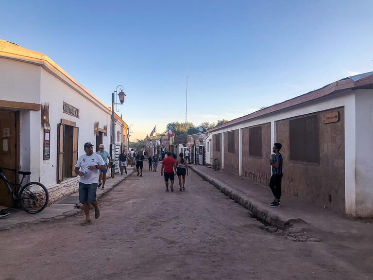 people walking down dirt streets San Pedro de Atacama