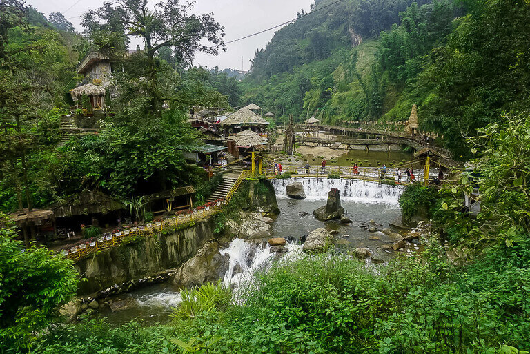Cat cat village on sapa itinerary green vegetation waterfall and wooden structures