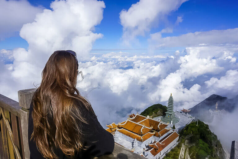 Kristen looking at temple above clouds Fansipan sapa vietnam