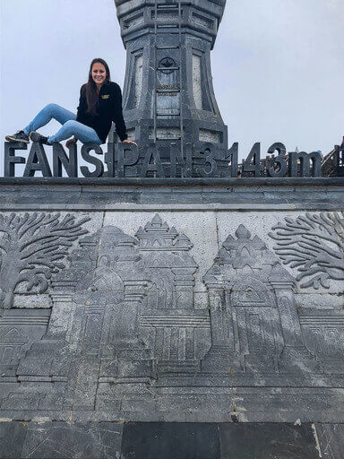 Kristen sat on Fansipan mountain letters made of stone sapa vietnam