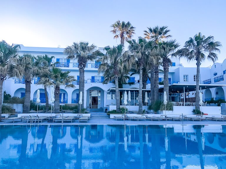 white hotel and blue pool in greece book accommodations hotels and hostels for travel