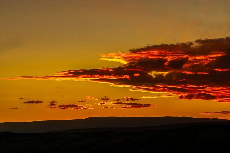 Incredible sunset deep red looks like flames between Capitol Reef and Escalante