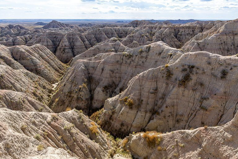 Badlands national park is an incredible alien landscape just over an hour from mt rushmore and one of the best things to do near Mount Rushmore on a South Dakota road trip itinerary