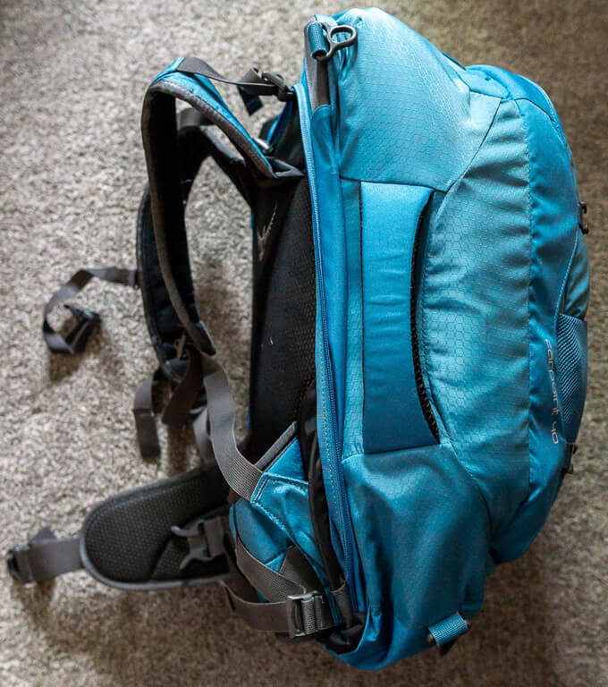 Blue Osprey Farpoint 40 side view with handle and straps