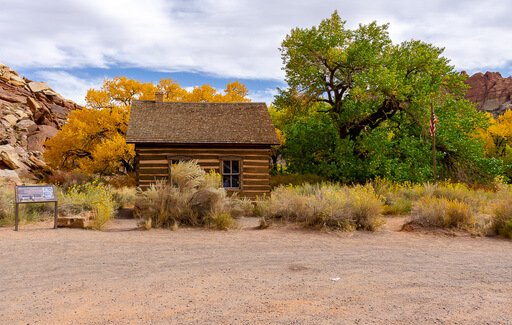 Side angle shot of fruita schoolhouse yellow and green trees