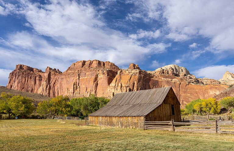 Fruita Barn in Capitol Reef National Park with huge orange rock behind