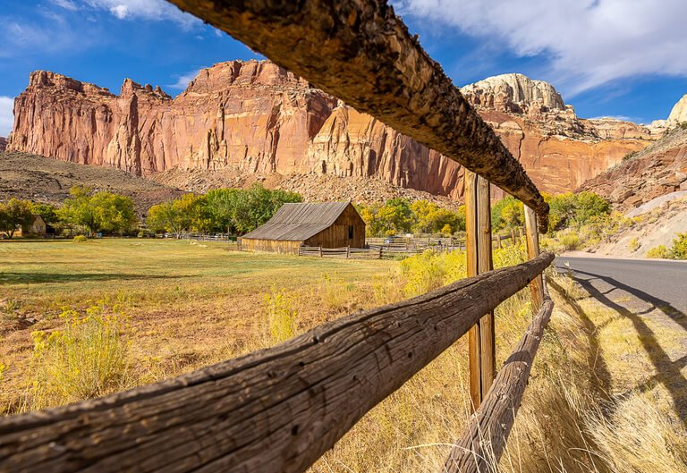 Gifford homestead barn Utah through fence shot