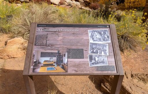 sign showing history of fruita schoolhouse capitol reef