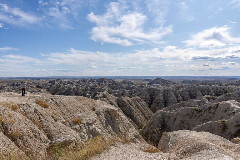 Kristen taking a photo at big badlands overlook South Dakota
