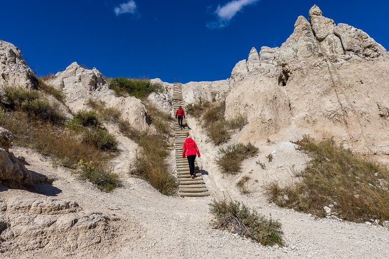 Mark and Kristen climbing wooden ladder on notch trail badlands