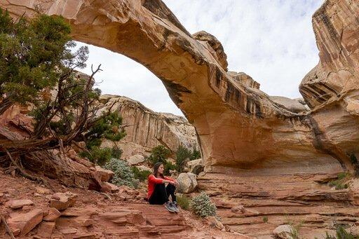 Kristen looking contemplative underneath Hickman bridge Utah