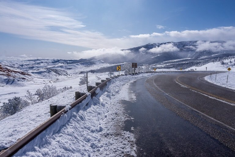 Road into Yellowstone northeast entrance US-212 covered in snow after heavy snowfall October