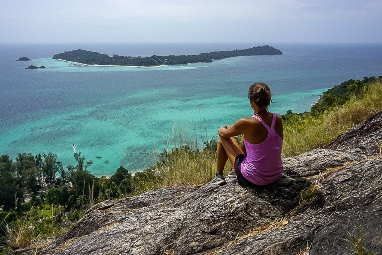 Kristen sat at the Koh Adang viewpoint overlooking Koh Lipe island shows the small size of Koh Lipe