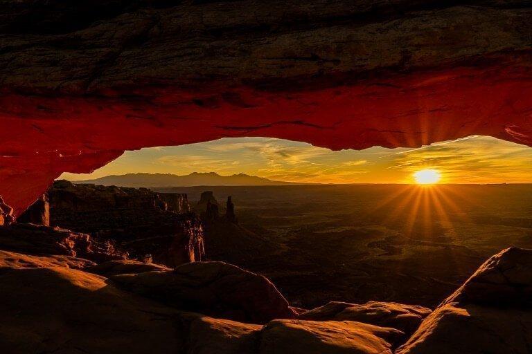 Underexposed dark sunrise at Mesa Arch in Canyonlands National Park Utah