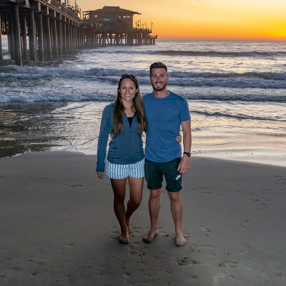 Sunset at Santa Monica Pier Los Angeles California Mark and Kristen on the beach orange sunset behind
