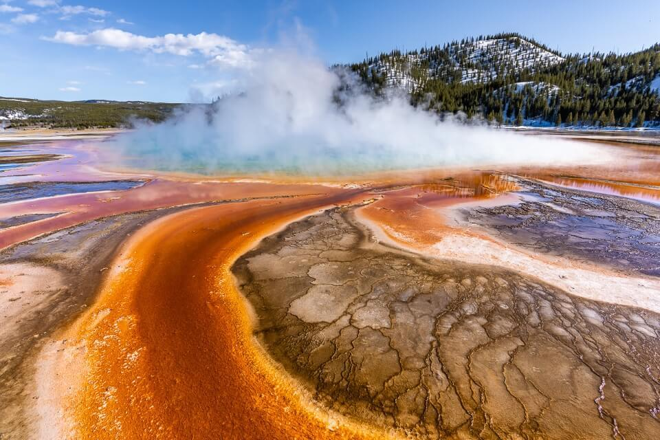 Yellowstone National Park 4 Day Itinerary Best Things to do Ultimate Guide Where Are Those Morgans incredibly vibrant colors swirling around Grand Prismatic Spring on a clear cold day loads of steam billowing