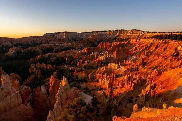 stunning deep red colors illuminating inside Bryce Canyon national park amphitheater Utah