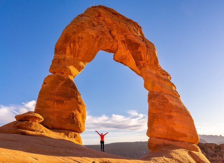 One day in Arches and Canyonlands Kristen where are those Morgans stood underneath stunning Delicate Arch towering overhead Utah National Parks