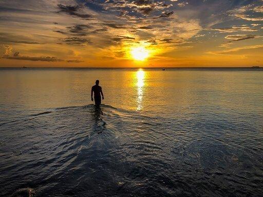 Travel Wellness mark in Thailand Koh Lanta beach sunset