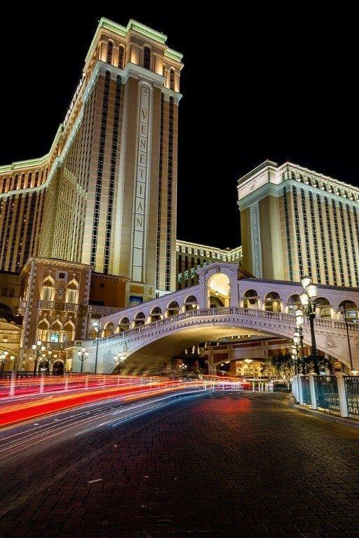 The Venetian Hotel in Las Vegas Lit up at night and car lights long exposure Utah road trip
