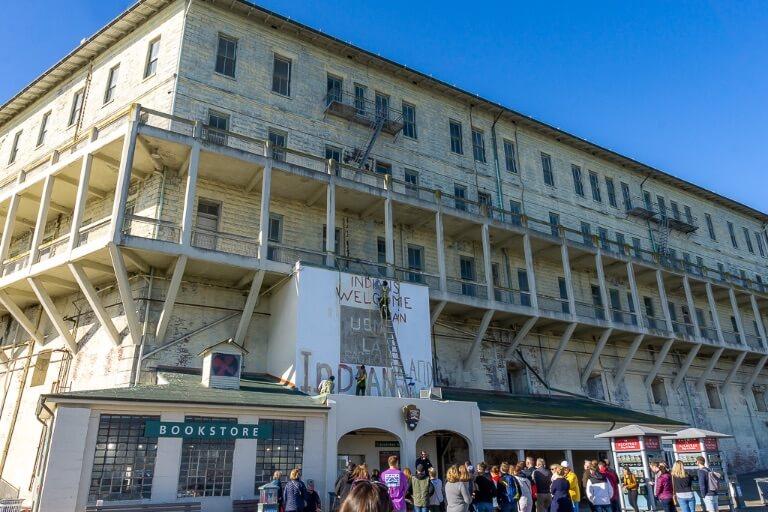 Tour group gathering around ranger at beginning of Alcatraz tour