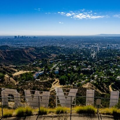 Hollywood sign overlooking Los Angeles city daylight California