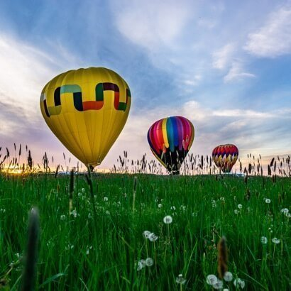 Upstate New York Hot Air Balloons Lifting Off from grassy field