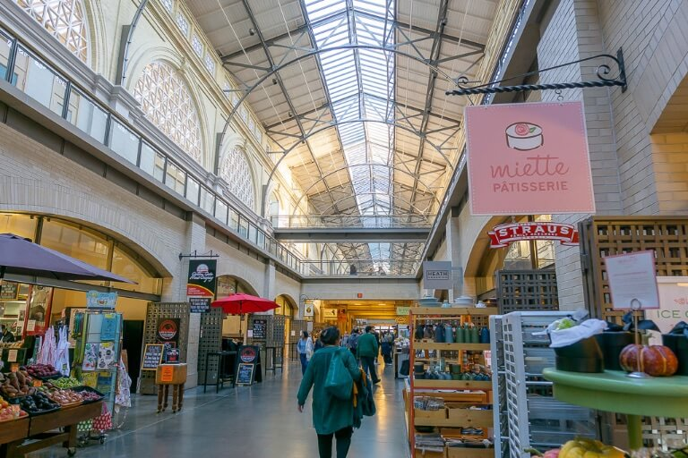 Ferry building and marketplace plus farmers market inside boutique stores and coffee shops