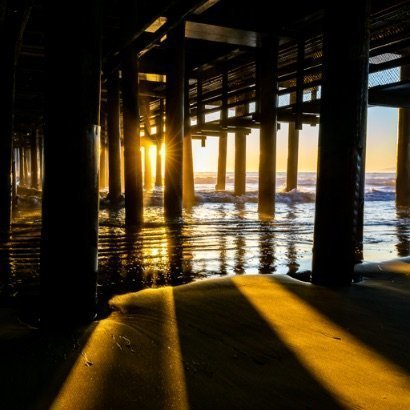Santa Monica pier underneath at sunset stunning colors