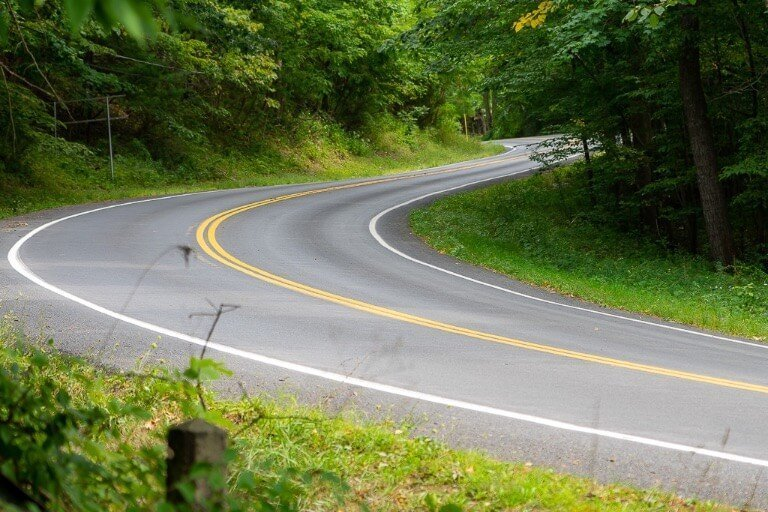 Winding road leading to north entrance of Ithaca state park in New York