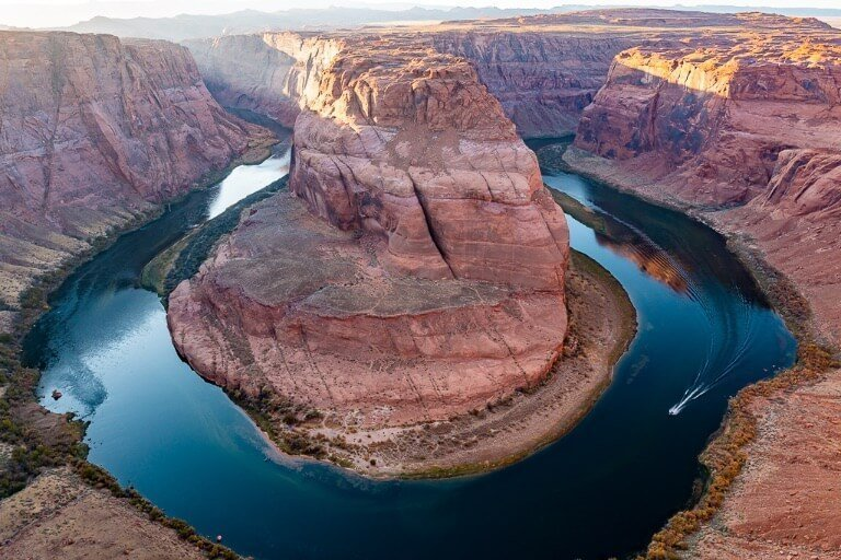 Awesome reflection on Colorado River with speedboat at Horseshoe Bend AZ