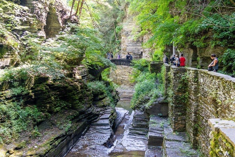 Interesting river bed formation running dry with stone bridge crossing at state park near Ithaca New York