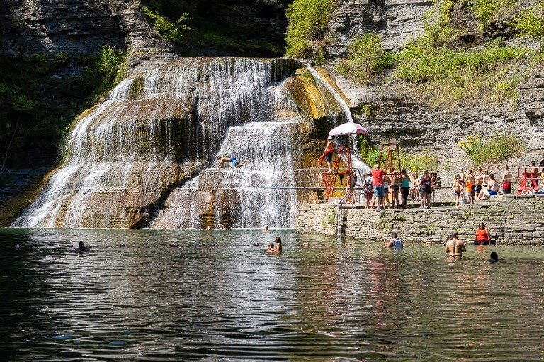 Lower falls at Robert H treman state park swimming hole with lifeguard and diving board