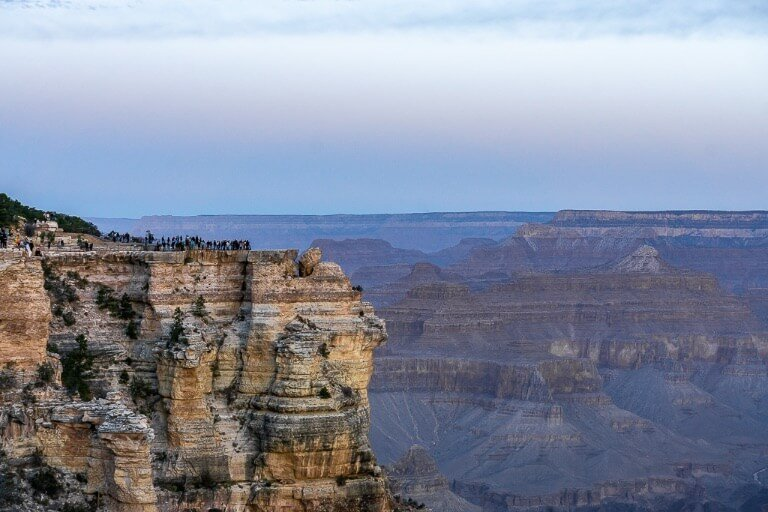Mather Point at sunrise is busy with tourists who can't miss an epic sunrise
