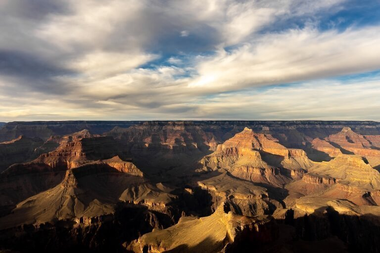 Just before sunset at Mohave Point Grand Canyon South Rim gorgeous yellow hue and deep dark shadows cast in the canyon epic one day itinerary