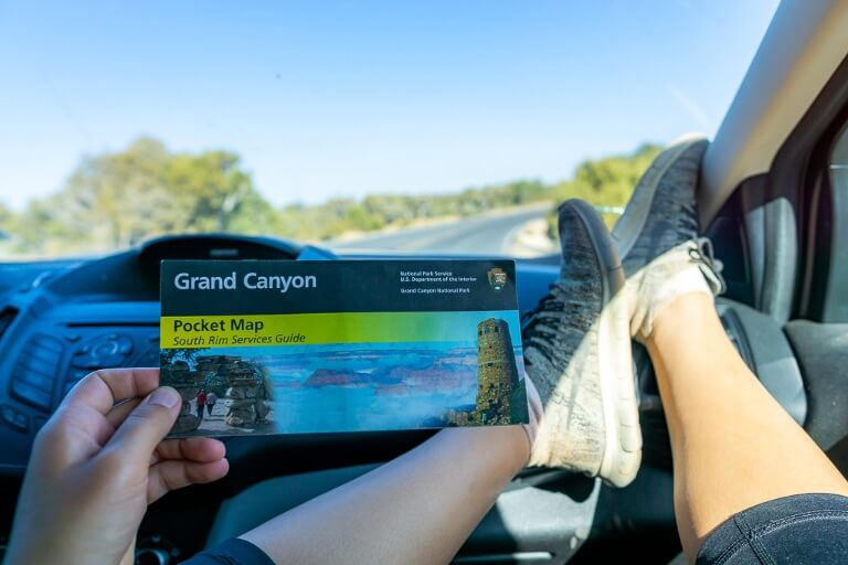 Entrance fee and parking at Grand Canyon south rim kristen holding NPS map inside car