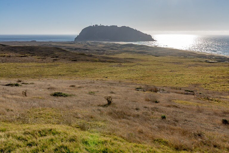 Point Sur lighthouse and naval facility sits on an island like headland jutting out into the Pacific Ocean